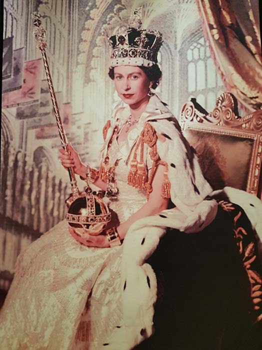 The official portrait of Queen Elizabeth II taken by Cecil Beaton after her coronation in 1953. She is wearing the Imperial Crown, with the Lesser Star of Africa.