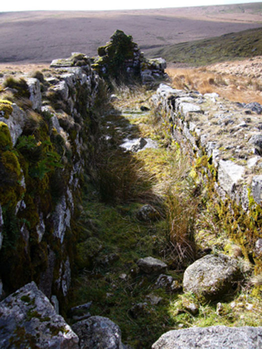 The remains of the wheelpit at Huntingdon mine on southern Dartmoor, where tin and cooper were mined. (Herbythyme / CC BY-SA 4.0)