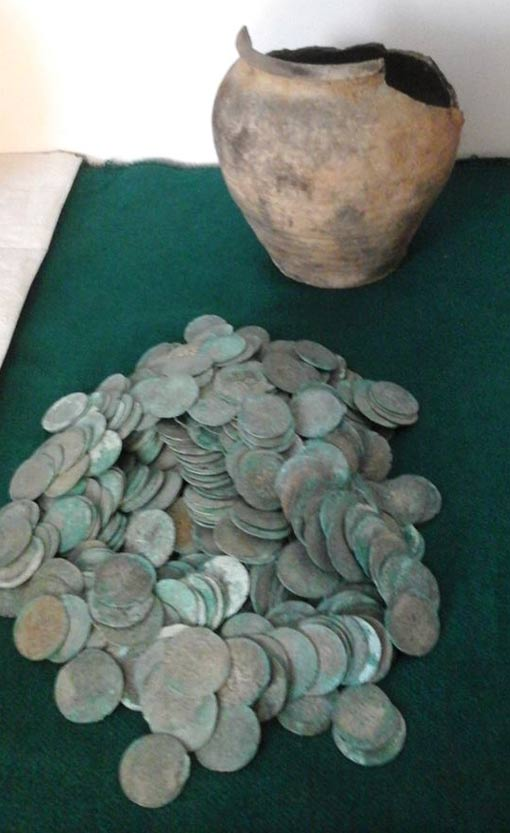 Treasure: The tarnished coins found in clay jars by a forester in Poland.