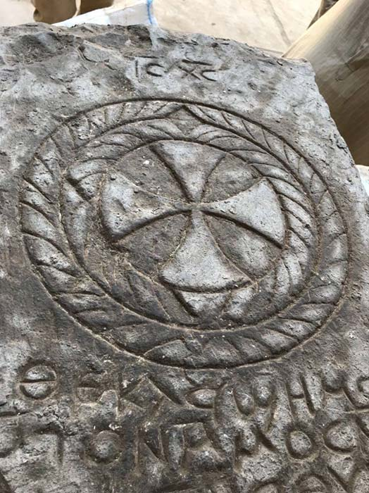 The tombstone is engraved with a cross and Coptic inscription, one word of which has been translated as 'Jesus'. (Image: Egypt Ministry of Antiquities)