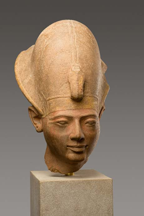 This elegant quartzite head wearing the Blue Crown originally belonged with the body of a statue that still stands in the great Hypostyle Hall of the Temple of Amun at Karnak; the inscriptions show that it had been carved for the short rule of King Amenmesse. Following Merenptah, Amenmesse had apparently seized the throne from the rightful heir, Seti II who was subsequently able to retake the throne. Later, he reinscribed this statue, like most of the others carved for Amenmesse, with his own name.