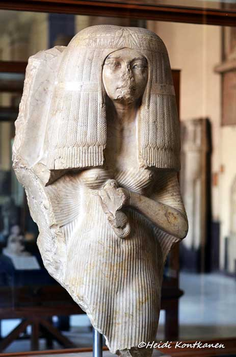 This elegant statue fragment of an unnamed woman is made of crystalline limestone. It originally formed a double with what is left of her husband, the army general Nakhtmin's head (now at the Luxor Museum, pictured above). Egyptian Museum, Cairo.