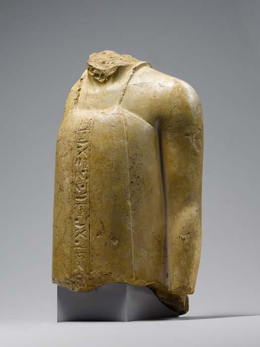 "This fragmentary statue made of indurated limestone represents a vizier from the Amarna Period. Columns of inscription refer to the ""beautiful light"" and the ""sole sun of the one who lives seeing him"" — language that clearly signals the Amarna religion. Metropolitan Museum of Art, New York. (Public Domain)"