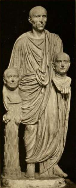 "The so-called ""Togatus Barberini"": a Roman senator holding effigies of deceased ancestors; one is part-supported by a herm. Marble, late 1st century BC; head (not belonging): middle 1st century BC. (Public Domain)"