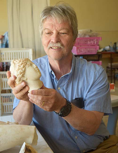NC State Professor of History Tom Parker examines a statue of Aphrodite, discovered during 2016 excavations in Petra, Jordan.