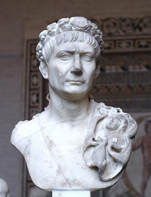 Bust of Trajan with the Civic Crown, a sword belt and the aegis (attribute of Jupiter and symbol of divine power).