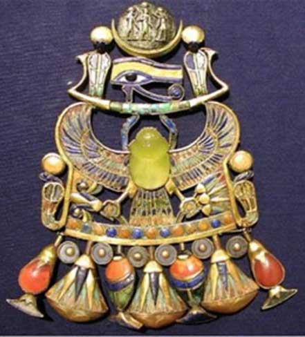 Tutankhamun's brooch which contains a striking yellow-brown scarab made of a yellow silica glass stone, produced when an ancient comet entered the earth's atmosphere.
