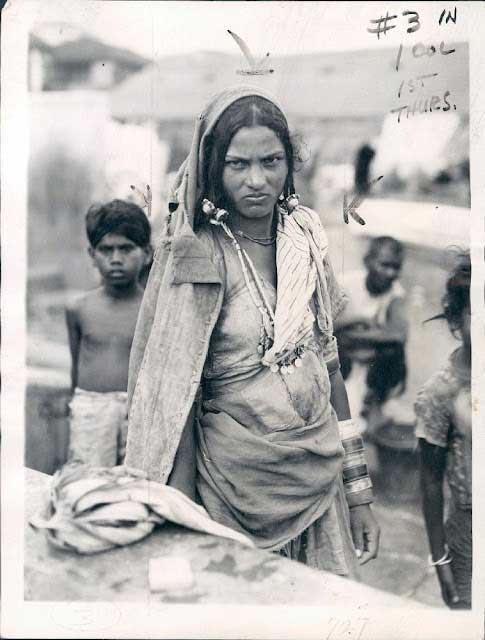 An 'Untouchable' woman of Mumbai, according to the Indian Caste System, 1942 (public domain)
