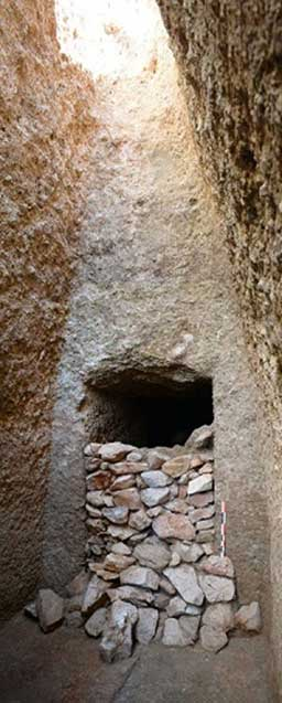 View of the Mycenaean-era tomb's façade and the dry-stone masonry that sealed the entrance.