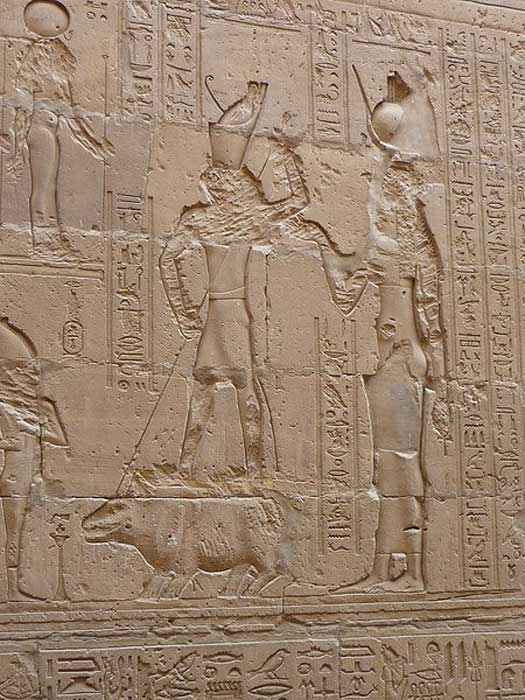 Wall relief of fight between Seth and Horus where Horus, helped by Isis, kill Seth (hippopotamus), temple of Edfu, Egypt. (Rémih/CC BY SA 3.0)