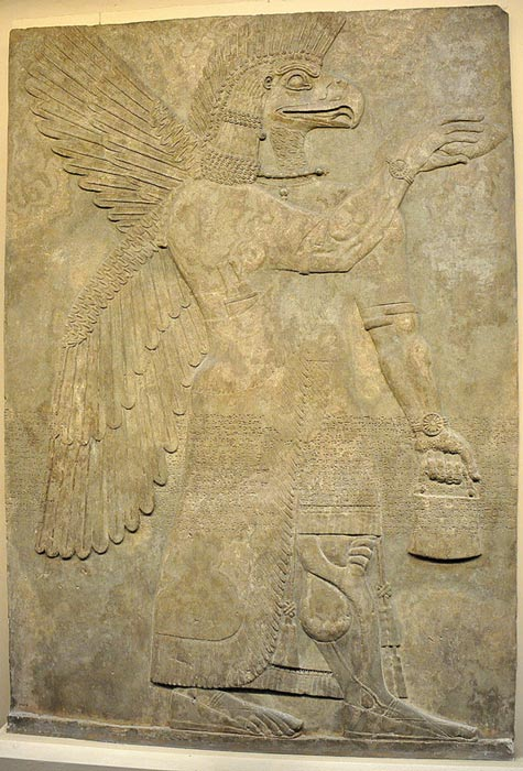 Wall relief depicting an eagle-headed and winged man, Apkallu, from Nimrud.