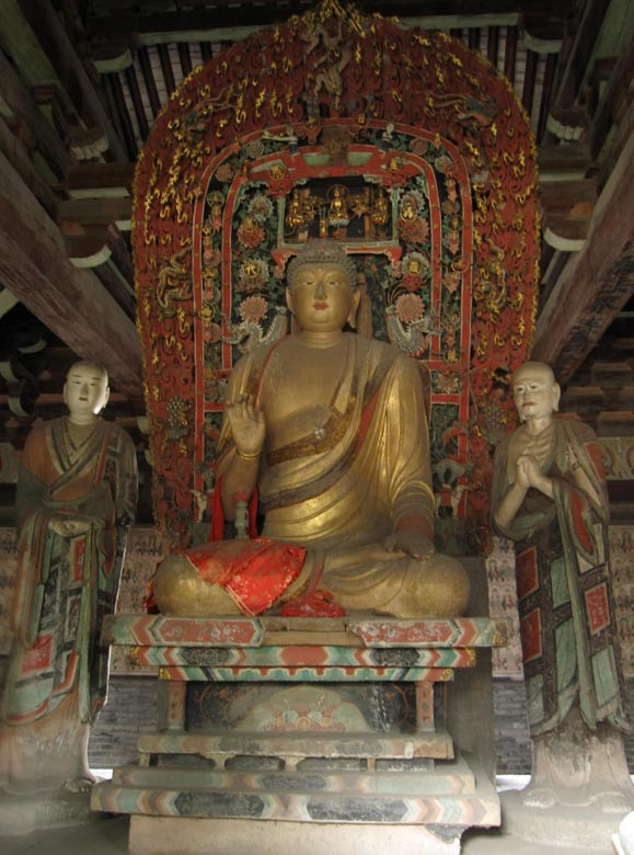 Statues within the Wanfo Hall at Zhenguo temple