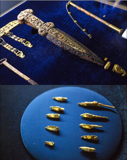 Weapon: an iron dagger and iron arrowheads with golden encrustation.