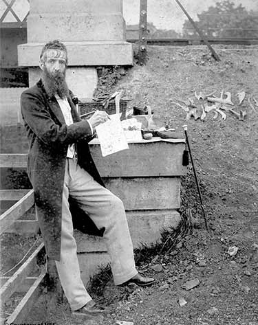 William Donnelly was at the center of the controversy, and his reputation as an archaeologist was damaged forever. He can be seen here posing with one of his sketchbooks. (Historic Environment Scotland)+