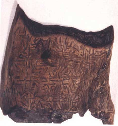 Wooden Dispilio tablet found at archeological site in Dispilio, Greece.