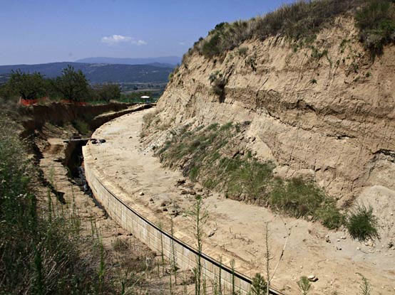A partial view of the site where archaeologists are excavating an ancient mound in Amphipolis