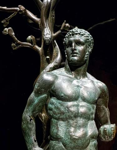 Bronze depiction of Nimrod/Herakles and the serpent-entwined apple tree from Byblos, Lebanon, 1st Century AD (Author provided)