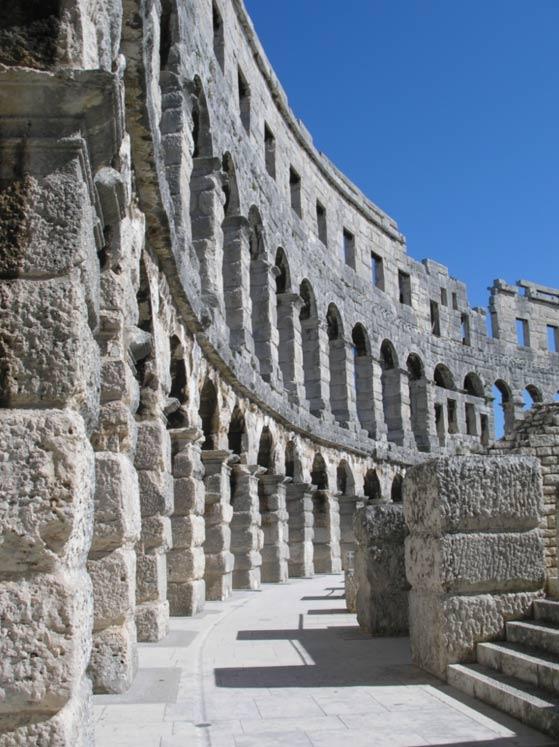 Restored arched walls at Pula.