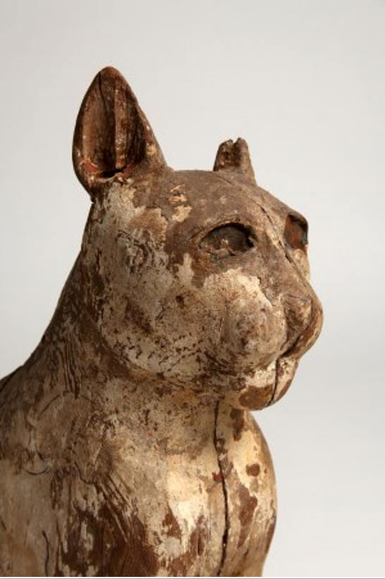 The artistically carved face of a mummified cat found in ancient catacomb in Egypt.