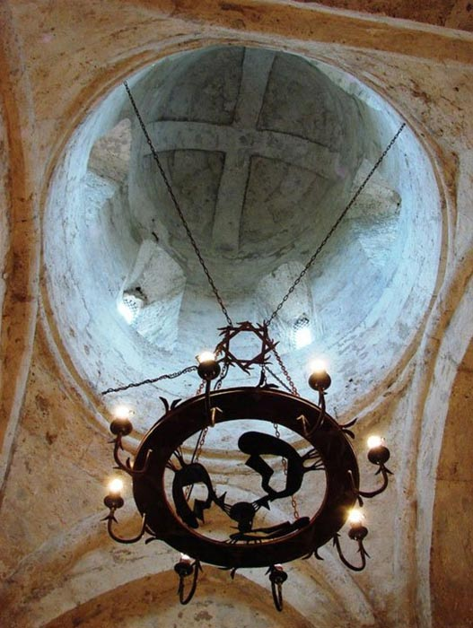 The beautiful domed interior of the Church of Kish, with ancient chandelier.