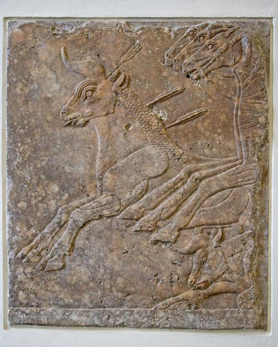 Refined low-relief section of a bull-hunt frieze from Nineveh, alabaster, c. 695 BC