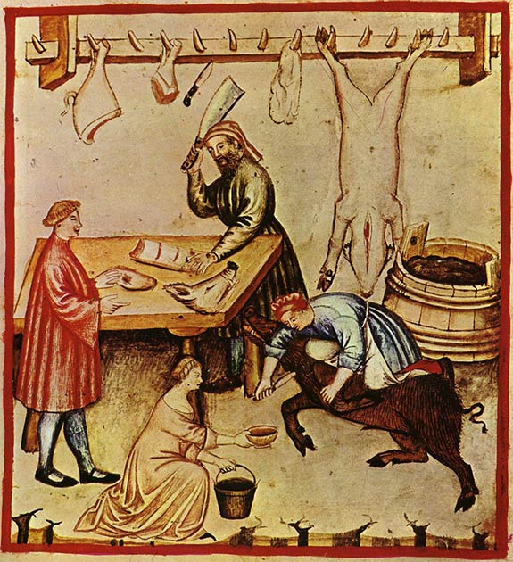A 14th-century butcher shop. A large pig is being bled in preparation for slaughter. A whole pig carcass and cuts are hanging from a rack and various cuts are being prepared for a customer. (Public Domain)