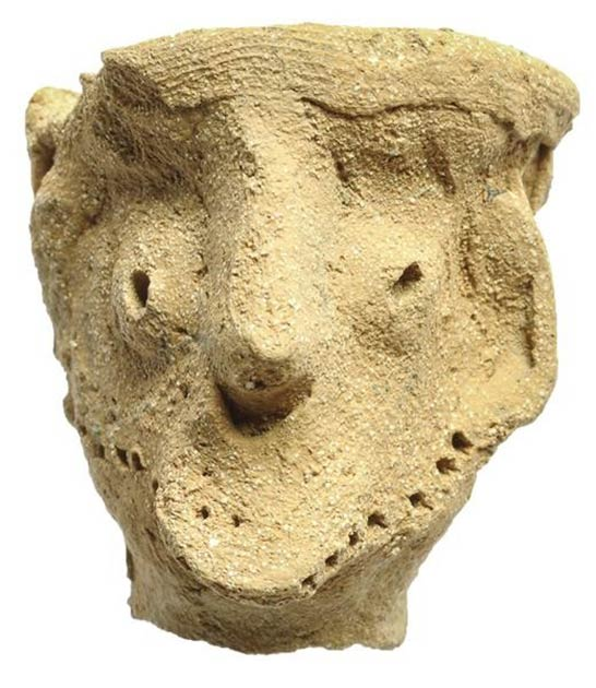 This clay male figurine was found at the Tel Moẓa temple along with another male figurine and two horse artifacts. Dated to the late tenth or early ninth century BC, it has pronounced facial features and wears a headdress. Garfinkel describes it as similar to the Qeiyafa figurine, and believes it may be a Yahweh Idol, representing Yahweh or another male god. (Clara Amit / Israel Antiquities Authority)