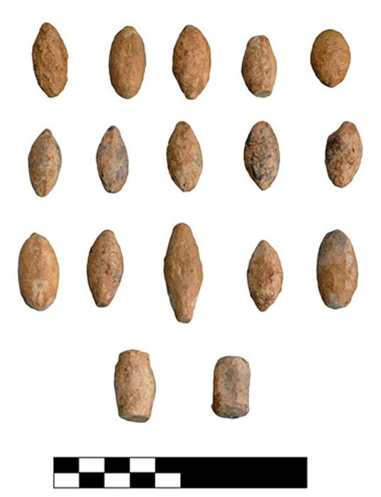 Excavations have turned up these clay sling bullets, possibly used in an attack that destroyed the town.