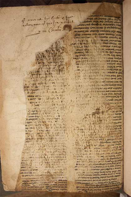 A close-up of one of the fragments showing damage to the text and an inscription in the host volume. (Don Hooper / University of Bristol)