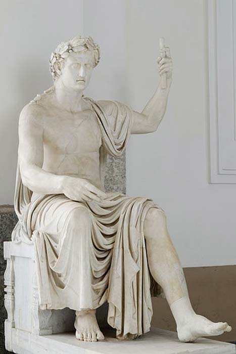 A colossal statue of a seated Augustus (Octavian) with a laurel crown