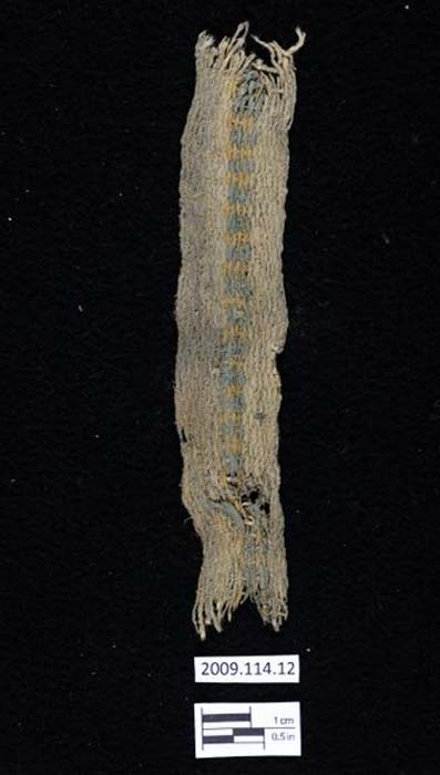 A cotton band or belt from Huaca Prieta which is 4100 -3500 years old. It has an indigo-blue center stripe and yellow ochre.