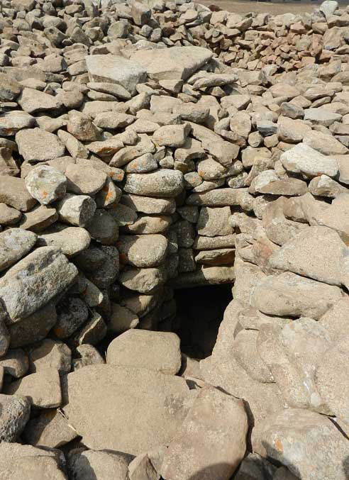 The dark entrance to the burial chamber found at the center of the megalithic site.