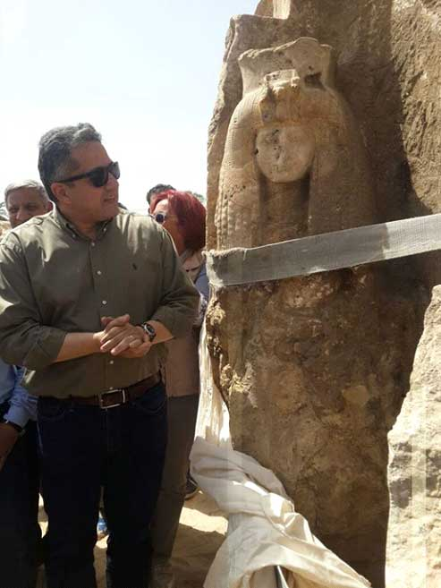 Minister of Antiquities examining the discovery of the Queen Tiye statue. Credit: Ministry of Antiquities