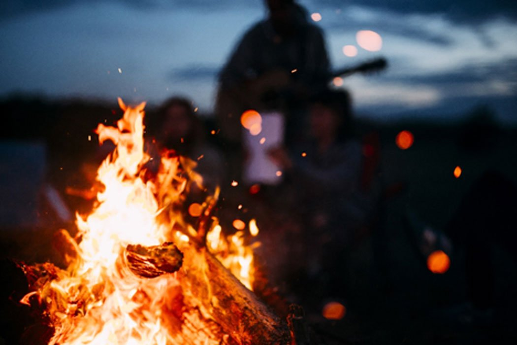 Christian group burns 'satanic objects' in bonfire. Credit: Andris / Adobe Stock
