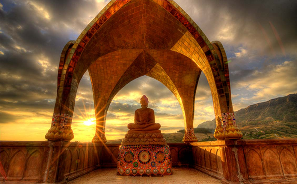 Sunset behind Buddha Image at Wat Phasornkaew