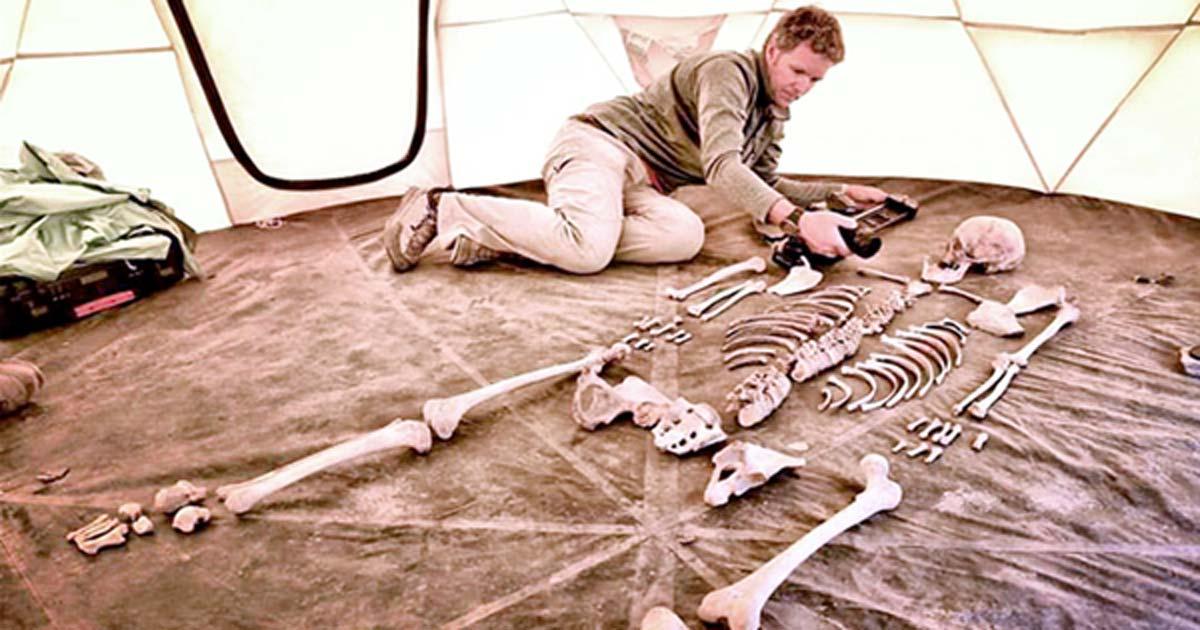 Researcher and filmmaker Jake Norton photographs a 1,200-year-old skeleton from Samdzong, Nepal.