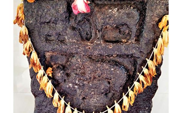 Ancient tablet depicting lewd scene  - India