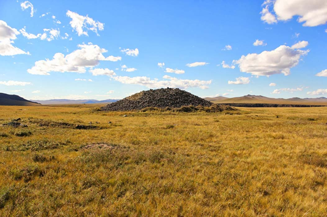 Central mound of a khirigsuur complex (burial mound) in the Asgatiin Valley.