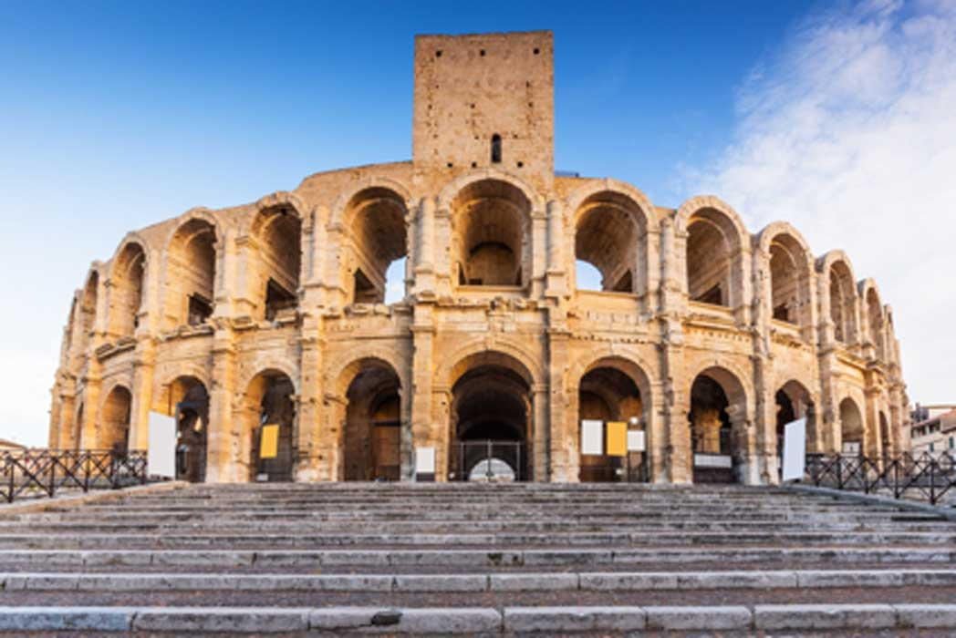 Arles Amphitheatre. Photo source: emperorcosar / Adobe Stock.