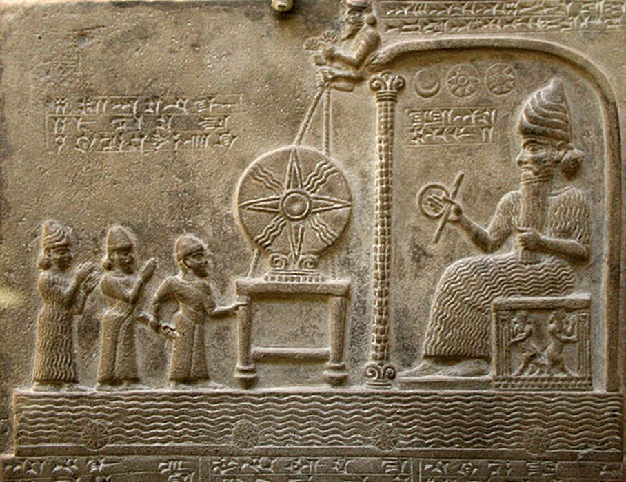 Relief image on the Tablet of Shamash, British Library room 55. Found in Sippar (Tell Abu Habbah), in Ancient Babylonia; it dates from the 9th century BC and shows the sun god Shamash on the throne, in front of the Babylonian king Nabu-apla-iddina (888-855 BC) between two interceding deities. The Babylonian language text tells how the king made a new cultic statue for the god and gave privileges to his temple.
