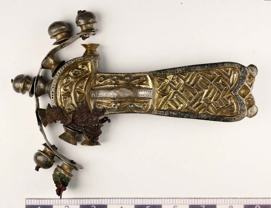 Archaeologists discovered an ancient Bohemian buckle during their excavations. Here it can be seen after conservation, with textile remnants visible on the head. Source: H. Březinová, R Černochová / Institute of Archaeology of the ASCR