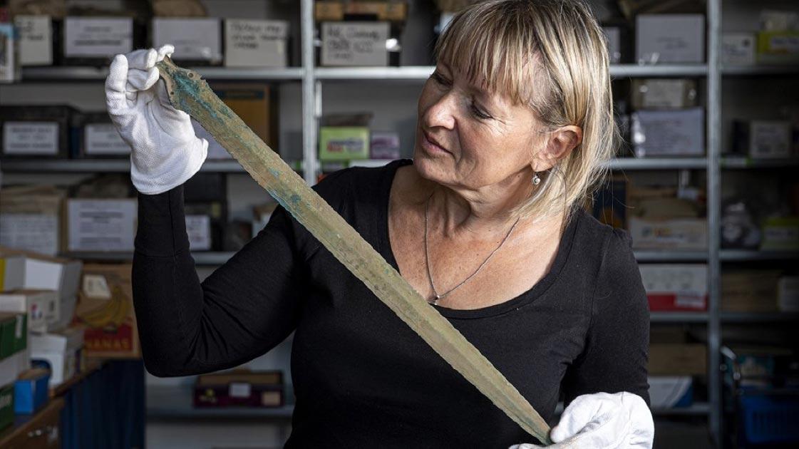 Martina Bekova of the Rychnov Museum with the Bronze age sword.             Source: David Tanecek, CTK