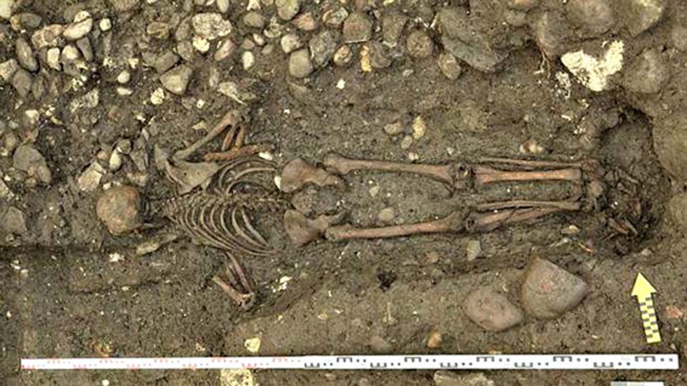 Buried Face Down with a Bag of Coins: Mysterious 17th Century Grave Discovered in Switzerland