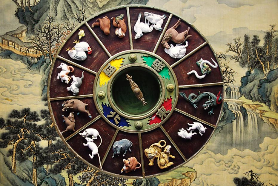 Carvings depicting the Chinese Zodiac on the ceiling of the gate to Kushida Shrine in Fukuoka, Japan.
