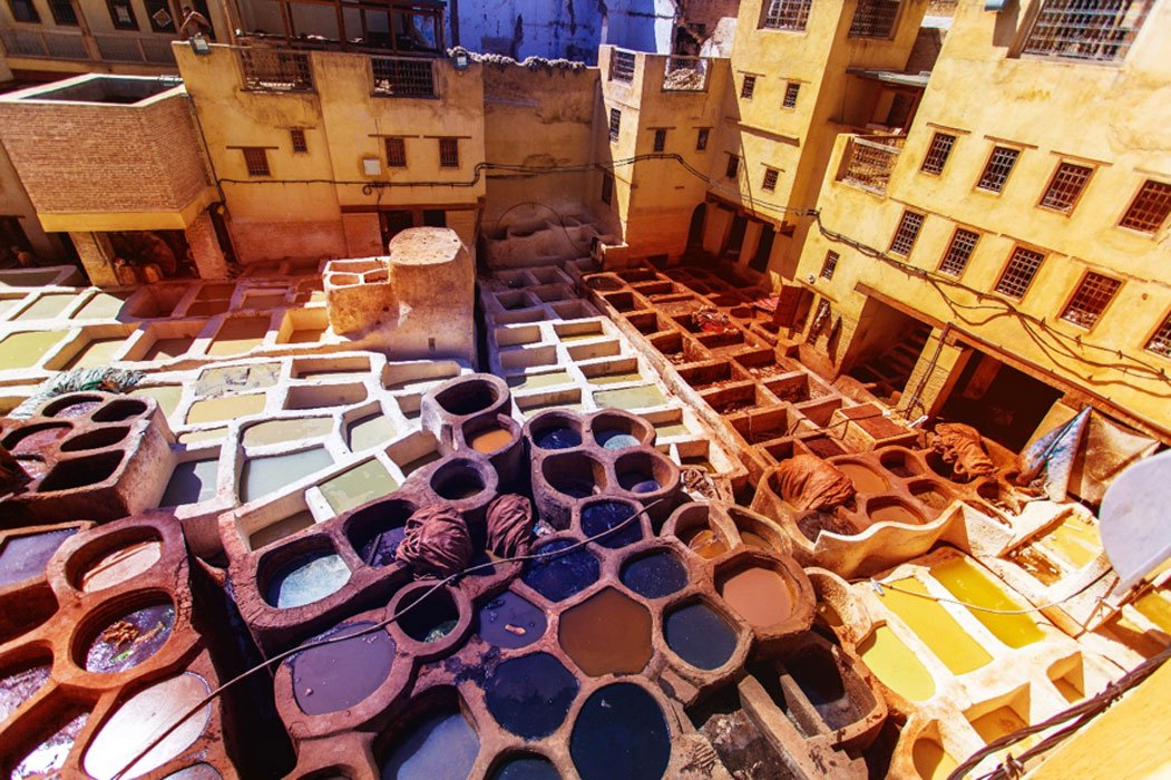 Scraping hides at the Chouara Tannery, the largest of the Fez's leather tanneries and the oldest in the world.