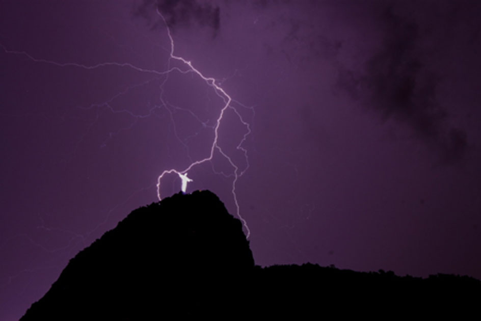 Christ the Redeemer struck by lightning. Credit: Cecilia / Adobe Stock