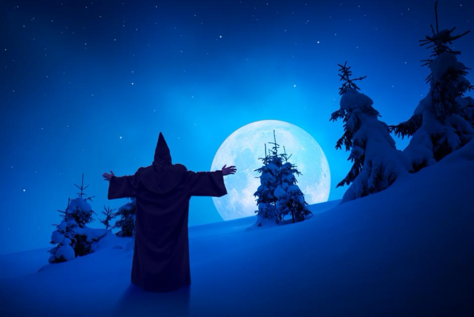 Depiction of a Christmas ghost standing under the moonlight in the snow. Source: Bashkatov / Adobe Stock
