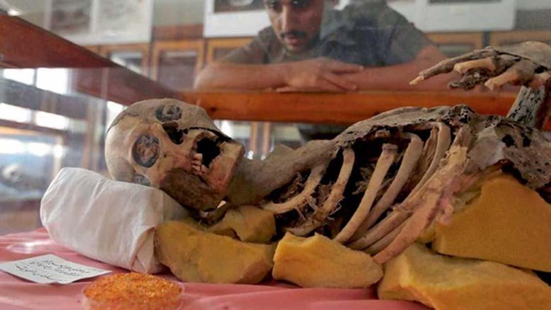 Student looks at millennia old mummy at Sanna University Mudeum, Yemen.