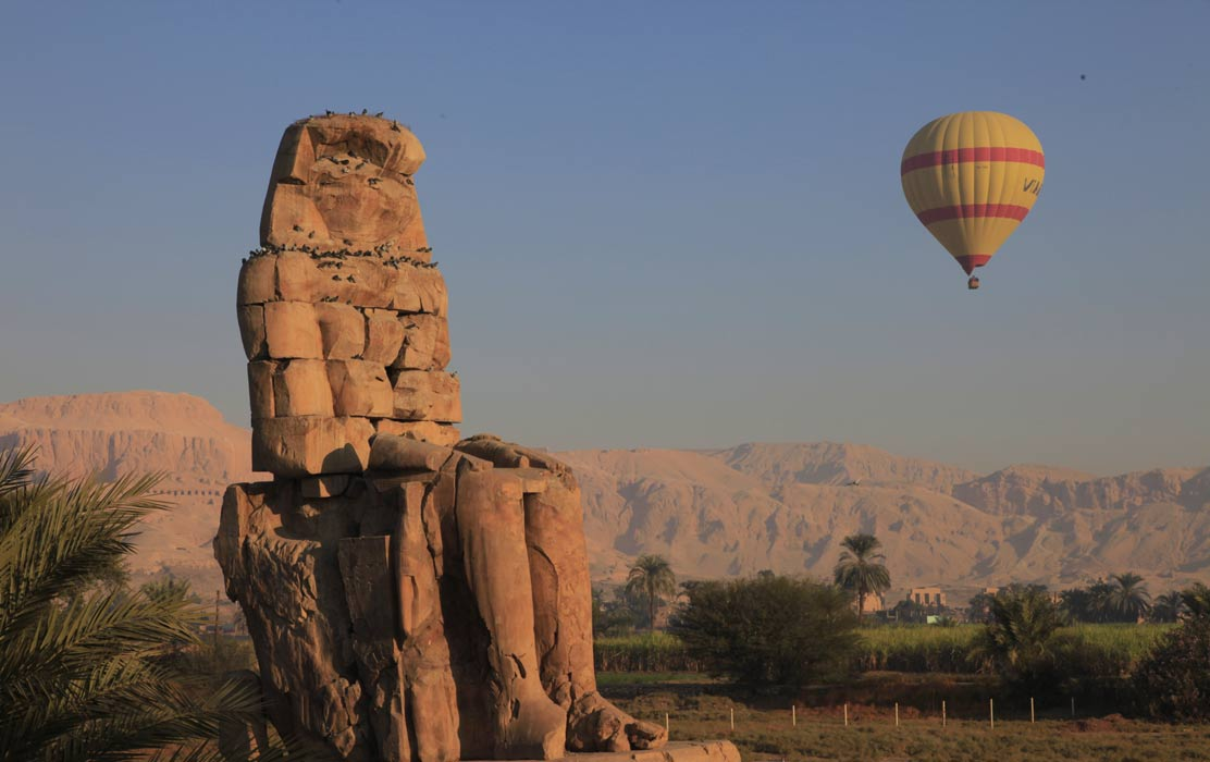 One of the iconic Colossi of Memnon statues.