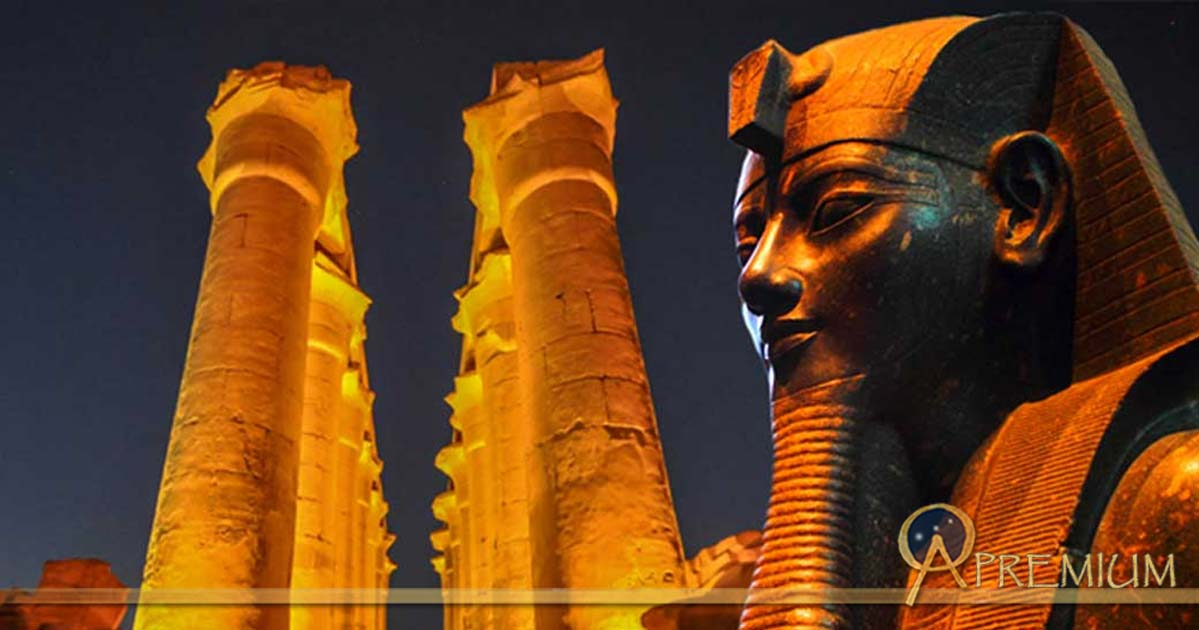 : The 14 columns of the The Colonnade of Amenhotep III - Luxor Temple and Statue of the Pharaoh